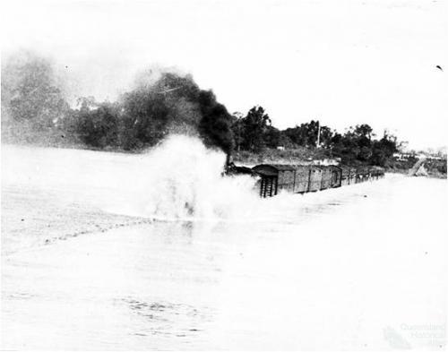 The Townsville Mail through floodwaters on the Burdekin Bridge, 1936