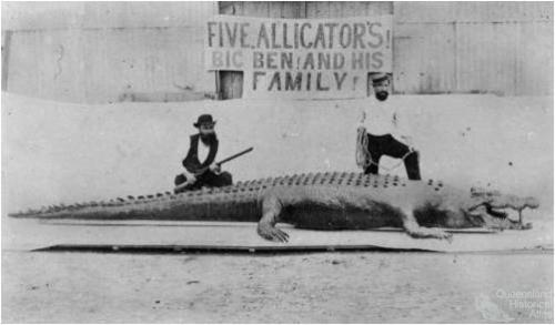 Two hunters posing with a dead crocodile, North Queensland, c1872