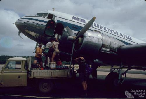 Loading cargo, Air Queensland DC3, Lockardt River airport, 1982