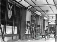 Repairing broken windows, American canteen, Brisbane 1942
