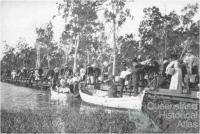 Railway passengers crossing Fitzroy River on flat wagons, c1900