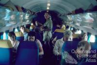 Passengers inside an Air Queensland DC3, 1982