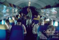 Passengers inside an Air Queensland DC3, 1982