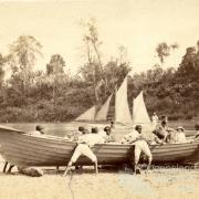 Native Troopers and boat, Lower Herbert River, early 1870s