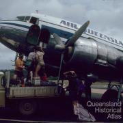 Loading cargo, Air Queensland DC3, Lockardt River airport, 1982