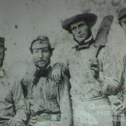 Tommy Wills (right) with cricketing colleagues, 1864